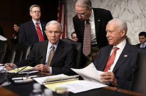 U.S. Sen. Jeff Sessions (R-AL) (3rd R) talks to Sen. Chuck Grassley (R-IA) (2nd R), and Sen. Orrin Hatch (R-UT) (R) prior to a hearing