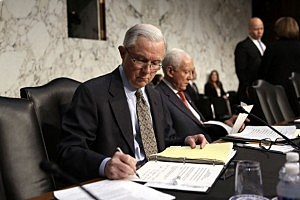 U.S. Sen. Jeff Sessions (R-AL) (L) and Sen. Orrin Hatch (R-UT) (2nd L) read documents prior to a hearing before the Senate Judiciary Committee