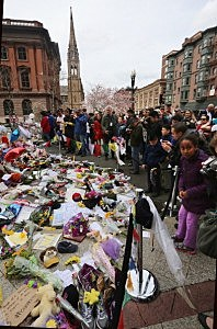 People gather at a makeshift memorial for victims near the site of the Boston Marathon bombings