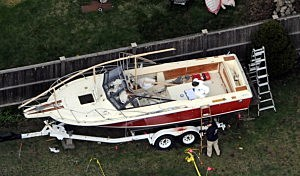 Investigators work around the boat where Dzhokhar A. Tsarnaev was found hiding after a massive manhunt