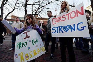 Adriana Passacantilli, 7, and her mother Sue participate in a candelight vigil for Roseann Sdoia who was seriously injured during the Boston Marathon