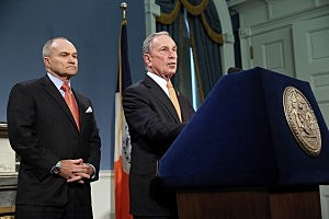New York City Mayor Michael Bloomberg (R) speaks during a news conference as Police Commissioner Raymond Kelly listens at City Hall