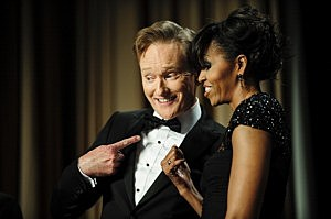 Conan O'Brien and first lady Michelle Obama pose for the cameras during the White House Correspondents' Association Dinner