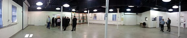 Panoramic shot of a building being renovated as a warehouse/manufacturing/office facility.