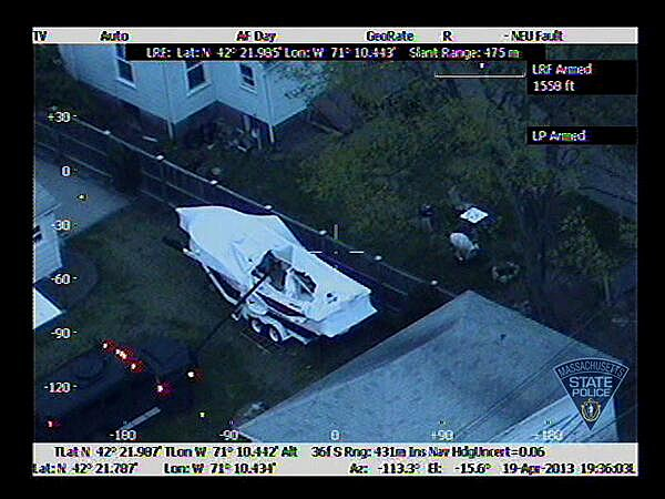 Photo from Massachusetts State Police Air Wing shows law enforcement approaching boat where Boston Marathon suspect Dzhokhar Tsarnaev hid