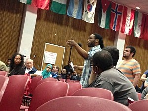 Audience member asks Dr. Barchi a question at Rutgers Newark town hall meeting
