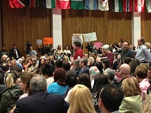 A line up to ask questions of Dr. Robert Barchi at Rutgers town hall in Newark