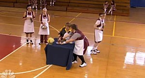 Players serve Coach Kelly meals at mid-court