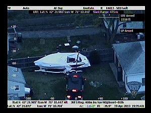 Mechanical device cuts open tarp of boat where where Dzhokhar Tsarnaev was hiding