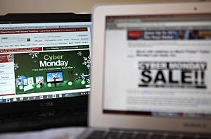In this photo illustration, an ad seen on the Target website for a Cyber Monday sale is displayed on laptop computers
