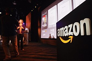 Members of the media cover the launch of the new Amazon tablet called the Kindle Fire