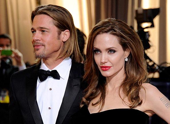 Actor Brad Pitt (L) and actress Angelina Jolie