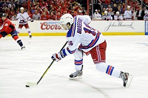 Derick Brassard #16 of the New York Rangers shoots the puck in overtime against the Washington Capitals