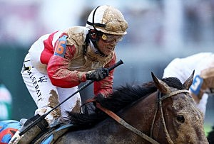 Joel Rosario atop Orb reacts after winning the 139th running of the Kentucky Derby