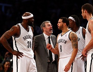 P.J. Carlesimo of the Brooklyn Nets talks with players Reggie Evans #30,Deron Williams #8,Gerald Wallace #45 and Brook Lopez #11 during a time out  game 7 of their playoff series with Chicago
