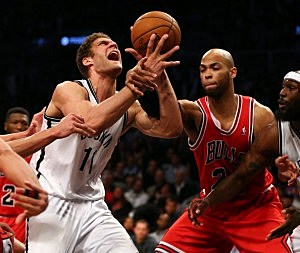 Brook Lopez #11 of the Brooklyn Nets is fouled by Taj Gibson #22 of the Chicago Bulls during Game Seven