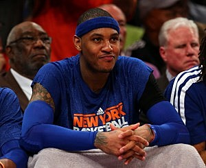 Carmelo Anthony #7 of the New York Knicks looks on from the bench in the third quarter against the Indiana Pacers