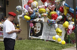 A Guardian Angel waits for the car carrying kidnap victim Gina DeJesus to arrive at her house