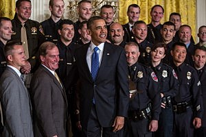 President Barack Obama poses for a picture with the 2013 National Association of Police Organizations TOP COPS award winners during a ceremony honoring them at the White House
