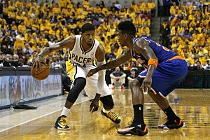 aul George #24 of the Indiana Pacers handles the ball against Iman Shumpert #21 of the New York Knicks