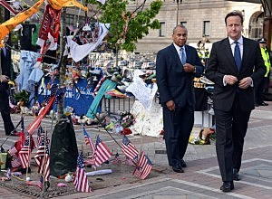 UK Prime Minister David Cameron and Massachusetts Governor Deval Patrick visit the memorial to the Boston Marathon bombing victims on Boylston Street