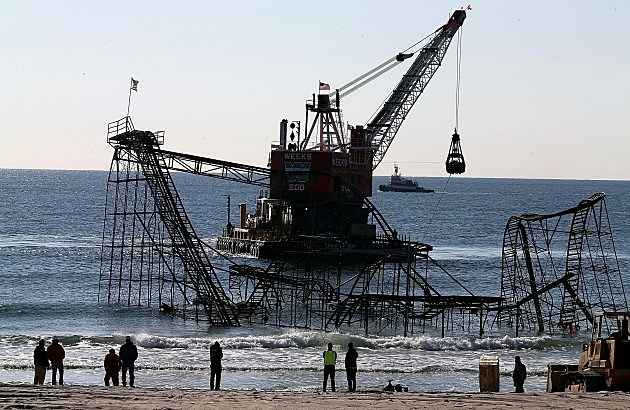 A barge moves in as workers prepare to remove the Star Jet roller coaster May 14, 2013 in Seaside Heights, New Jersey. (Photo by Mark Wilson/Getty Images)