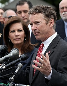 Sen.Rand Paul (R-KY) speaks as U.S. Rep. Michele Bachmann (R-MN) (L) and Sen. Ted Cruz (R-TX) (2nd L) listen during a news conference May 16, 2013 on Capitol Hill