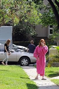 Neighbors watch a FBI evidence response team work