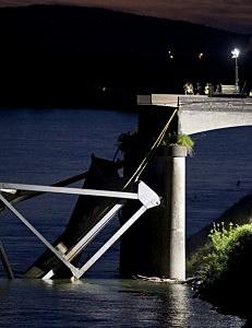 Crews survey the scene of a bridge collapse on Interstate 5