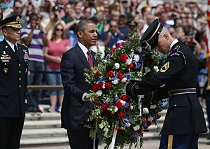 President Barack Obama positions a commemorative wreath during a ceremony on Memorial Day at the Tomb of the Unknowns at Arlington National Cemetery