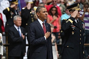 President Barack Obama and Major Gen. Michael S. Linnington stand before a wreath ceremony on Memorial Day at the Tomb of the Unknowns at Arlington National Cemetery