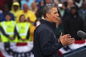 President Barack Obama speaks to crowds along a rain soaked boardwalk in Asbury Park