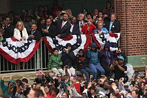 People in the crowd take photos and video as President Barack Obama speak