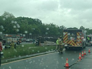 Overturned tractor trailer on Interstate 295 in Hamilton near Arena Drive