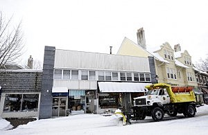 A snowplow clears the streets in Maplewood,