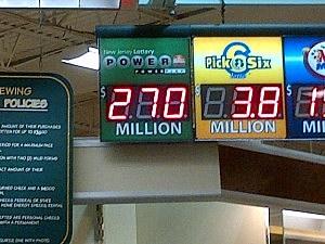 Sign displaying Saturday's Powerball jackpot