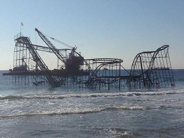 Construction barges ready to remove the Jet Star Roller Coaster in Seaside Heights, NJ (NJ101.5 / TownsquareMedia)