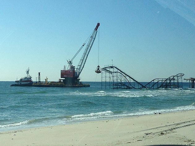 Demolition barge approaches Jet Star Roller Coaster in Seaside Heights prior to removal (NJ101.5 / Townsquare Media)