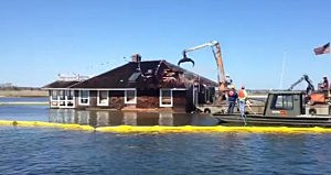 Demolition crews tear down a home in Barnegat Bay