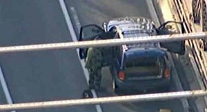 Bomb squad investigates suspicious package left with an unattended vehicle on the Brooklyn Bridge