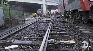 Crews work in Connecticut to restore rail service