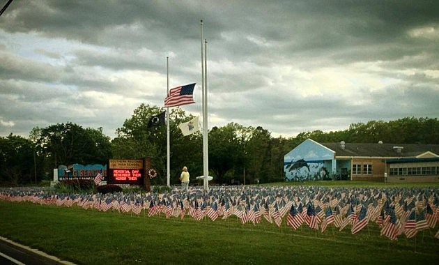 Fallen servicemen & women are remembered with flags in the front of Southern Regional High School in Manahawkin