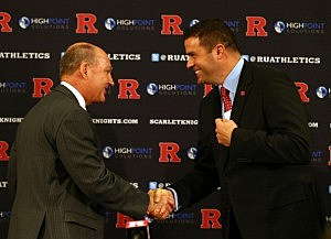 Big Ten commissioner Jim Delany shakes hands with Tim Pernetti, Athletic Director, during a press conference announcing that Rutgers University is joining the Big Ten Conference in November