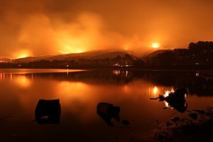 Fire surrounds Lake Elizabeth during the Powerhouse fire