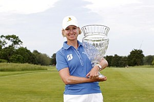 Karrie Webb of Australia holds the championship trophy after winning the ShopRite LPGA Classic in Galloway