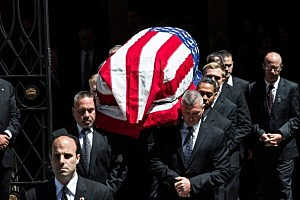 The casket of deceased New Jersey Senator Frank Lautenberg is carried out of the Park Avenue Synagogue after his funeral