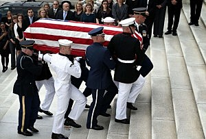 Members of a Armed Forces Casket Team carry the casket of the late U.S. Sen. Frank R. Lautenberg (D-NJ) up the Senate steps