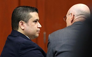 George Zimmerman listens to co-counsel Don West, on the first day of his trial in Seminole circuit court