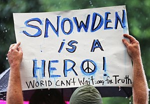 A supporter holds a sign at a small rally in support of National Security Administration (NSA) whistleblower Edward Snowden in Manhattan's Union Square