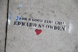 Graffiti that is sympathetic to NSA leaker Edward Snowden is seen stenciled on a San Francisco sidewalk